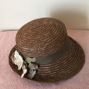 Straw hat / flowers inside approximately 22 inches
